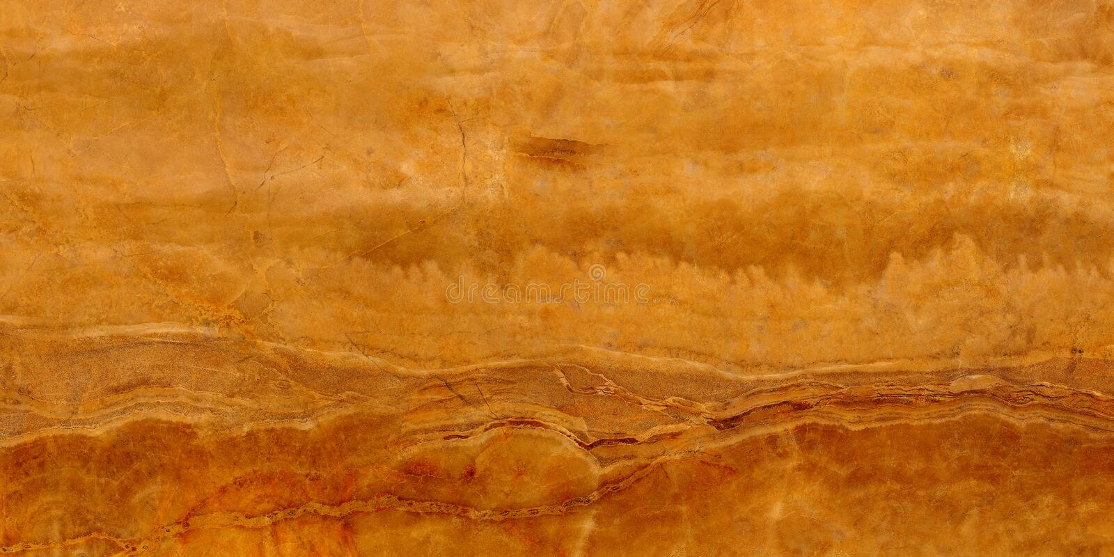 Translucent mineral onyx stone macro texture. Slice of natural agate stone for patterns and textures close up royalty free stock photo