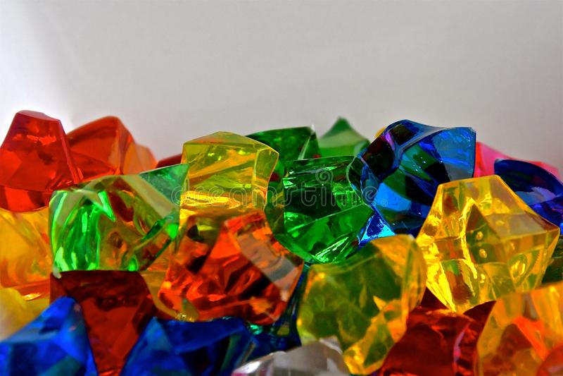 Translucent plastic gem stones stock photo