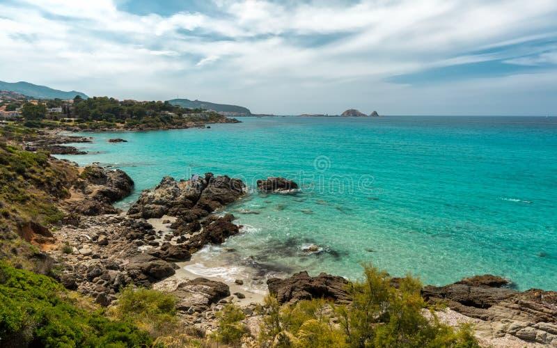 Translucent sea and rocky coastline of Corsica near Ile Rousse. Translucent turquoise sea, rocky coastline and beach near to Ile Rousse in the Balagne region of royalty free stock image