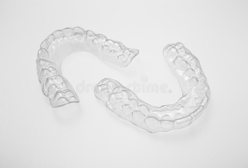 Translucent upper and lower essix retainers. On a gray background stock images