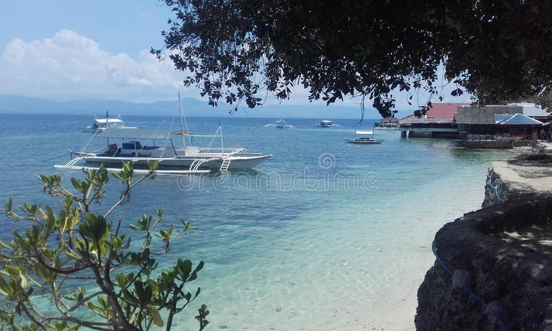 Translucent water Cebu island Philippines. Natural landscapes from Philippines Blue water with boat sunny natural day Cebu island Philippines royalty free stock image