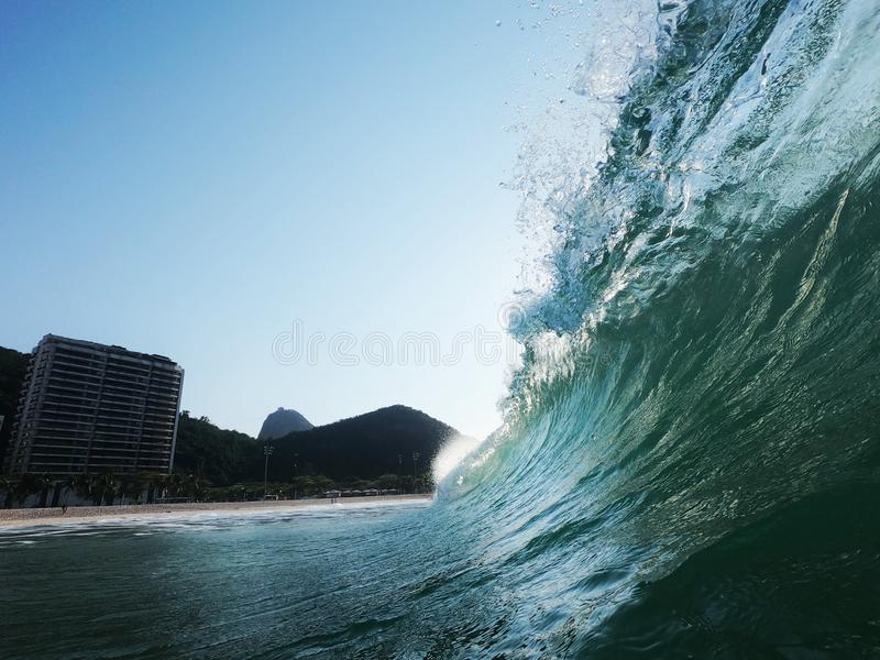 Translucent wave lip. Winter morning with a great wave in the beach break of Leme's beach,  Rio de Janeiro  - Brazil, lemes stock photo