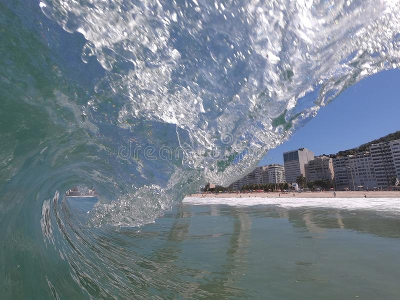 Translucent wave in Rio. Beautiful day with nice wave tube in the beach break of Leme's beach,  Rio de Janeiro  - Brazil, lemes royalty free stock images