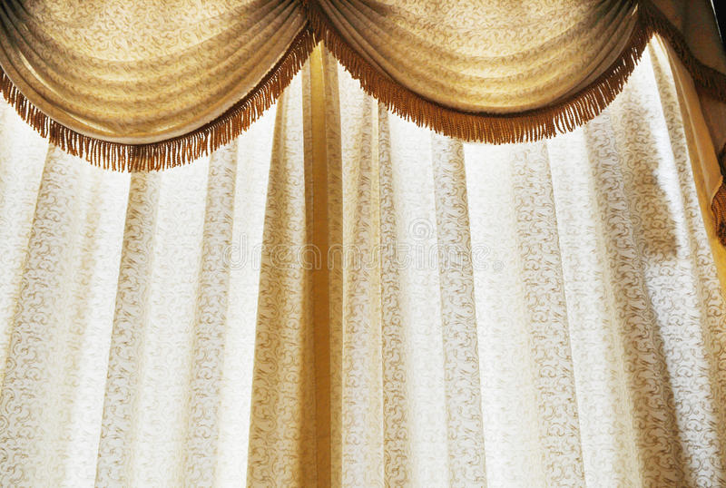 Translucent window curtain. Translucent window crape curtain of white color stock photo