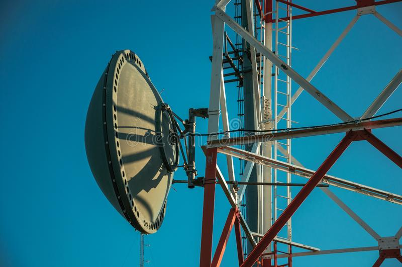 Transmission antenna dish in a telecommunication tower royalty free stock image