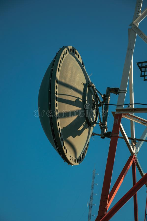 Transmission antenna dish in a telecommunication tower. Transmission antenna dish in a telecommunication cellular network tower on base transceiver station at royalty free stock photos