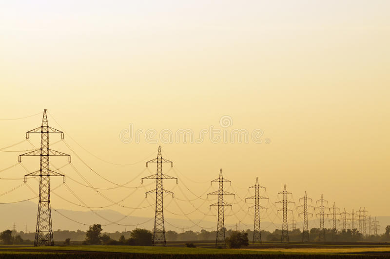 Transmission line at sunset stock photo
