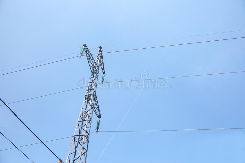 Transmission towers, pylons, power towers, adapted for high voltage electricity transportation and distribution stock image