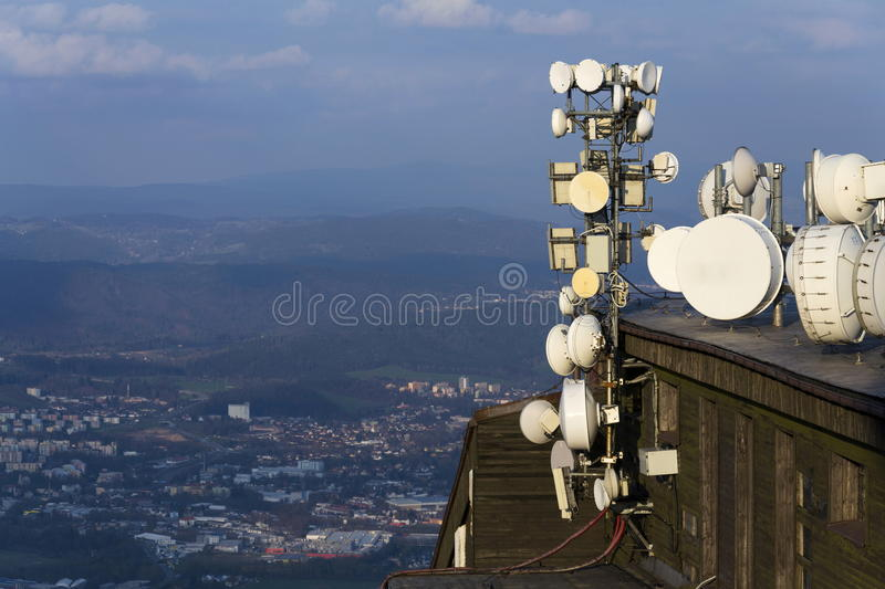 Transmitters and aerials on the telecommunication tower during sunset. Transmitters and aerials on telecommunication tower during sunset stock images