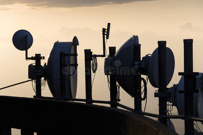 Transmitters and aerials on the telecommunication tower during sunset. Transmitters and aerials on telecommunication tower during sunset stock image