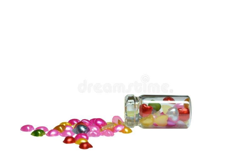Transparant flessenhoogtepunt van multi-colored harten royalty-vrije stock afbeeldingen