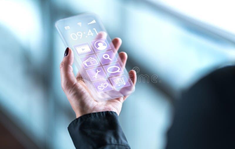 Transparante mobiele telefoon Futuristische glassmartphone stock foto's