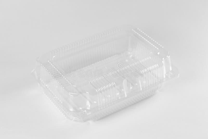 Transparante plastic container Sluit omhoog Geïsoleerd op grijze backgr royalty-vrije stock fotografie