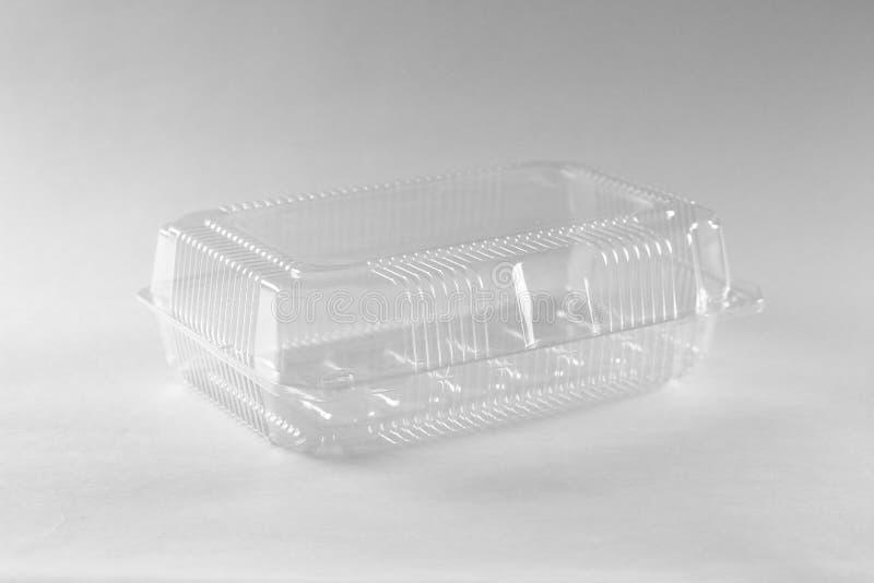 Transparante plastic container Sluit omhoog Geïsoleerd op grijze backgr stock foto