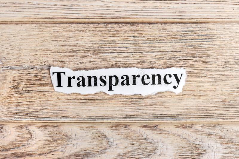 Transparency text on paper. Word Transparency on torn paper. Concept Image.  stock photo