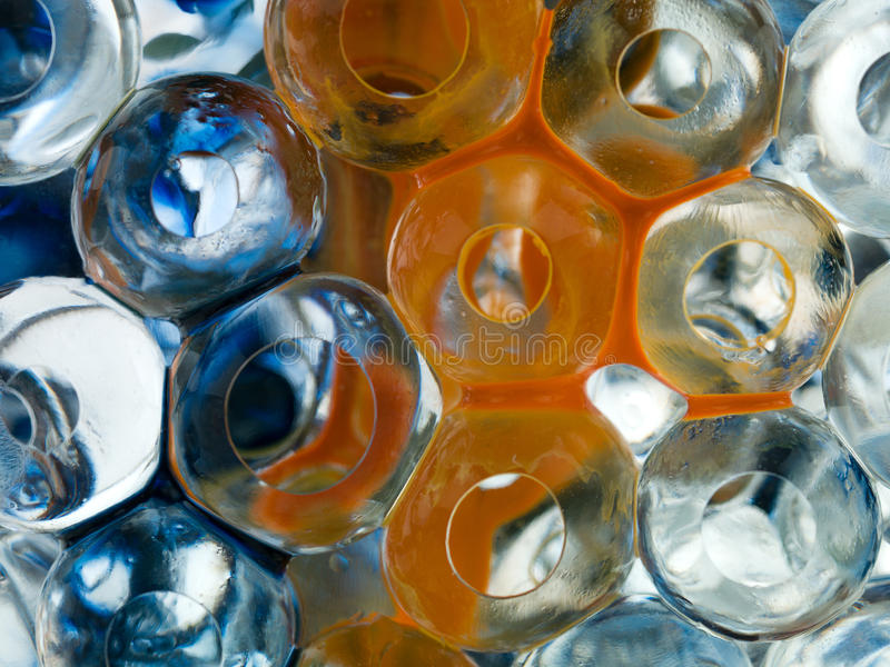 Transparent balls with orange pigment and blue ink. Detail stock images