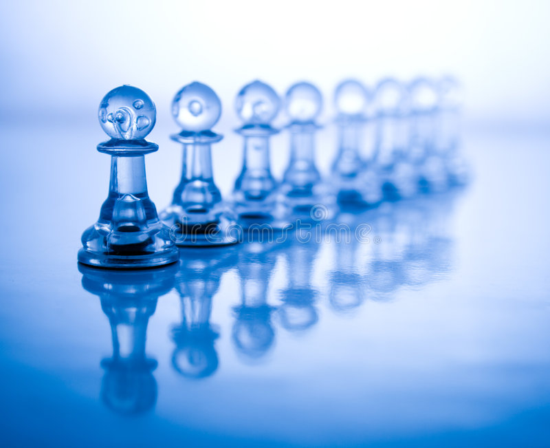 Transparent blue chess. Transparent chess on a blue background royalty free stock photography