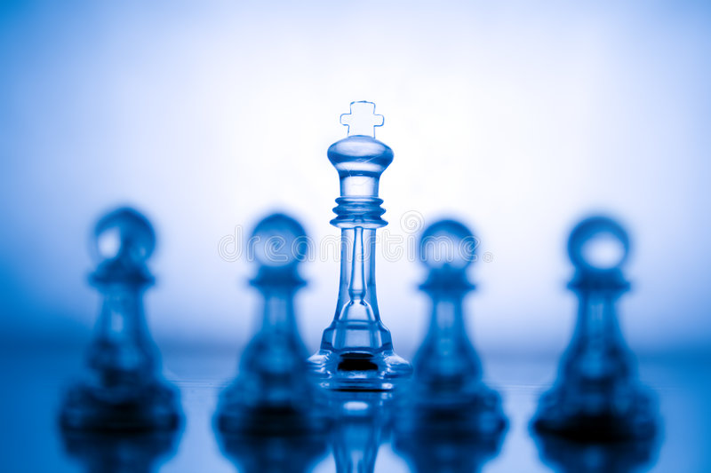 Transparent blue chess. Transparent chess on a blue background royalty free stock photo
