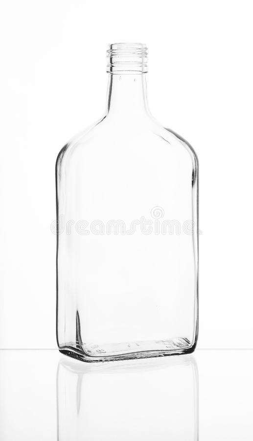 Transparent bright glass bottle. Transparent glass bottle with reflection royalty free stock images