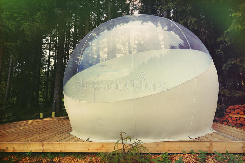 Transparent camping tent called bubble-tent to enjoy glamping in the Black Forest, Germany. Transparent camping tent called bubble-tent in the wood to enjoy stock photo
