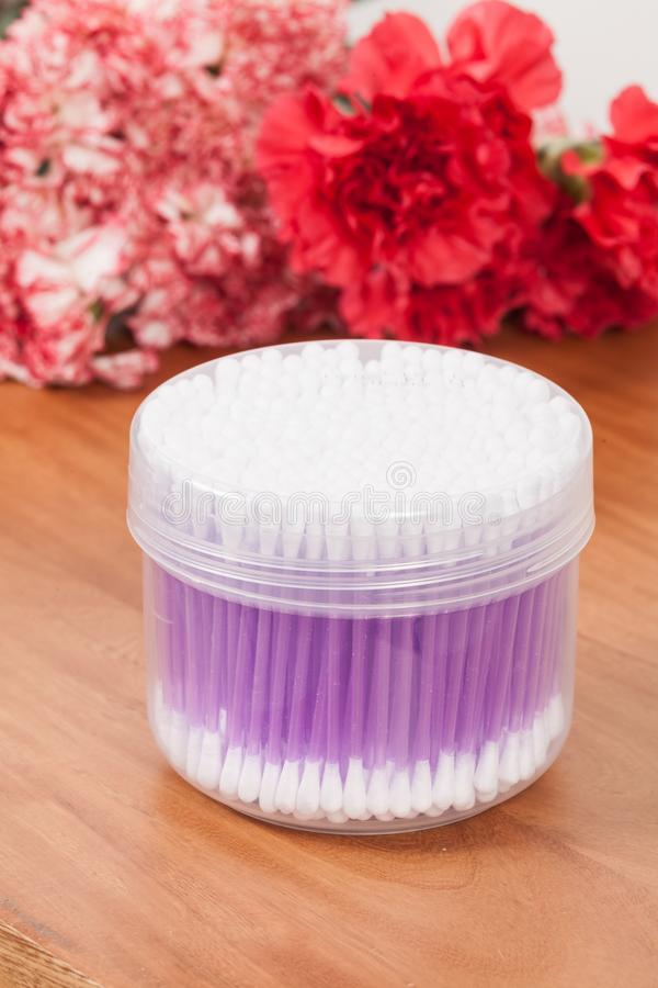 Transparent container with cotton swabs stock images