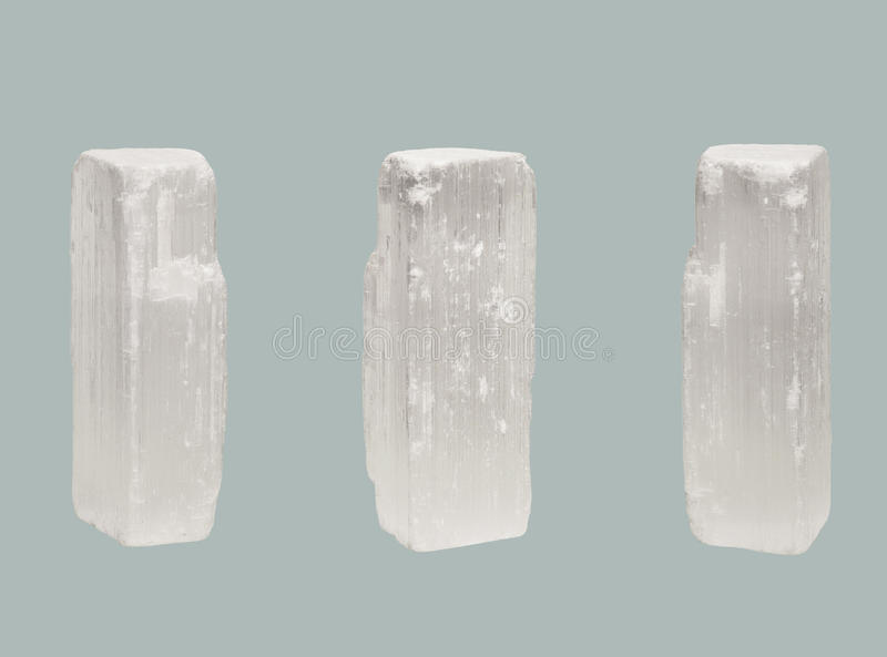 Transparent crystal of Selenite isolated on blue background royalty free stock photos