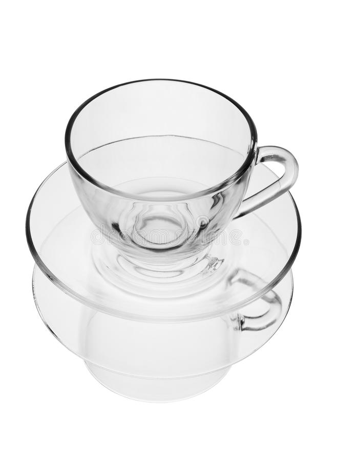 Transparent cup on a plate with reflection stock photos