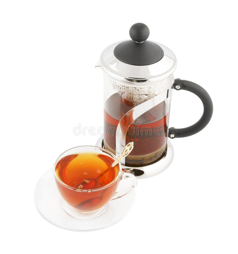 Transparent Cup Of Tea With Spoon And Teapot Royalty Free Stock Photo