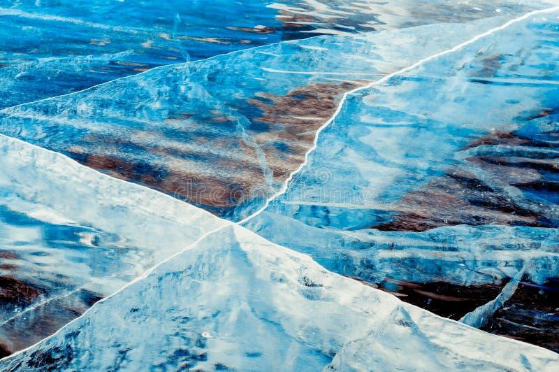 Transparent deep blue ice royalty free stock image