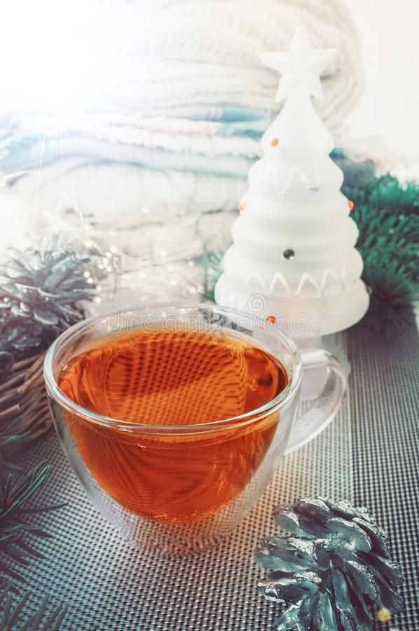 Transparent double bottom glass Cup with hot drink on table with Christmas decor. Warming drink in cold winter stock photography