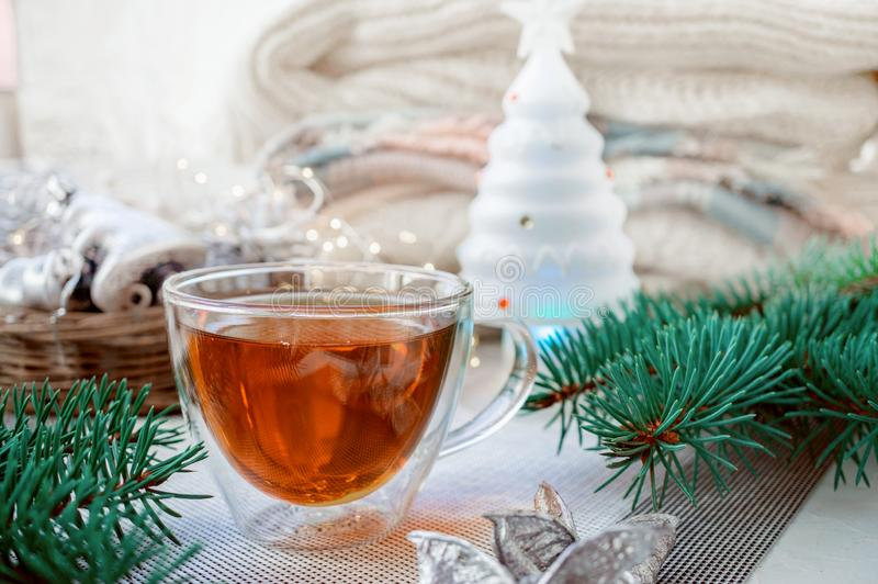 Transparent double bottom glass Cup with hot drink on table with Christmas decor. Warming drink in cold winter.  stock photography