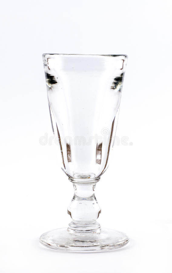 A transparent elegant crystal glass for cocktails on a white background.  stock photography