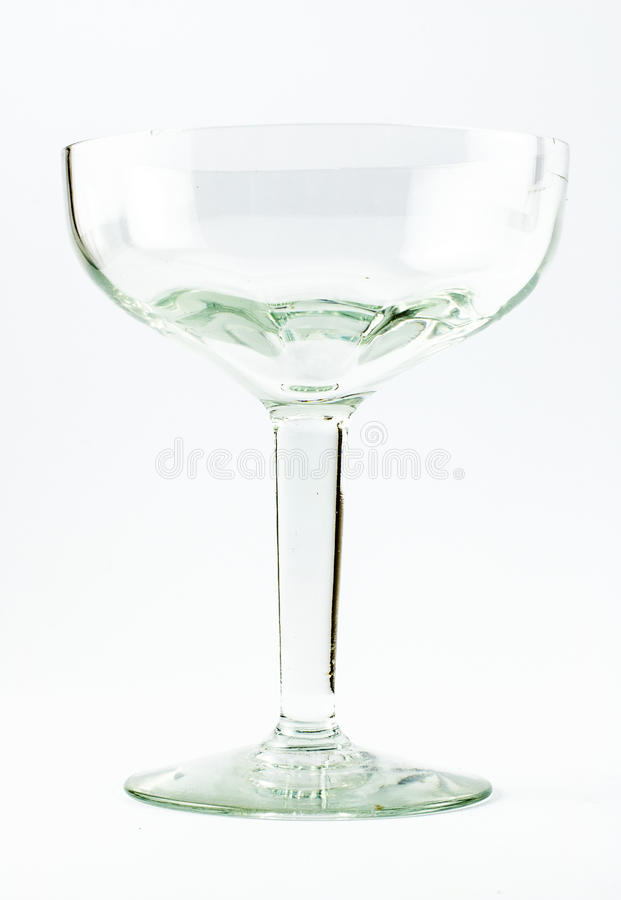 A transparent elegant crystal glass for cocktails on a white background.  stock images