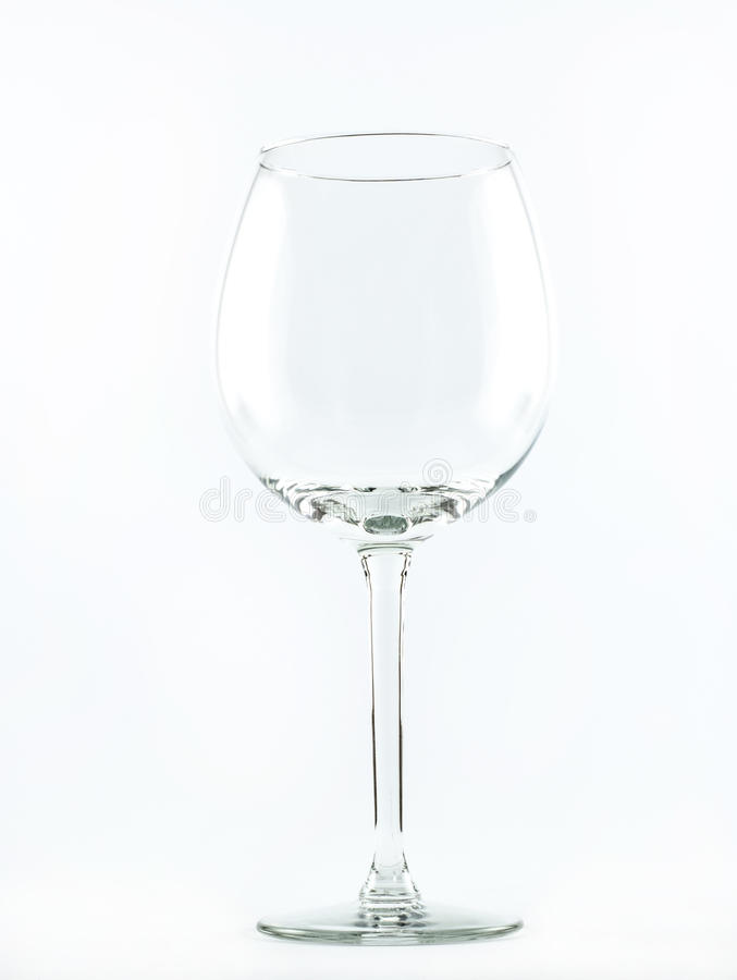 A transparent elegant crystal glass for cocktails and wine on a white background.  stock photography