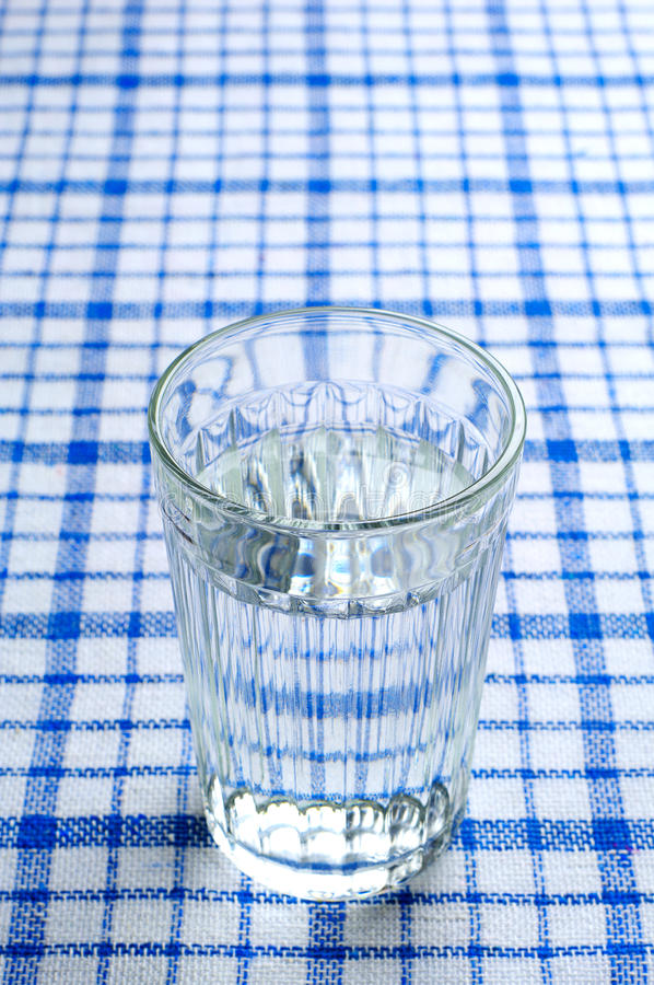 Transparent faceted glass of water stock photos