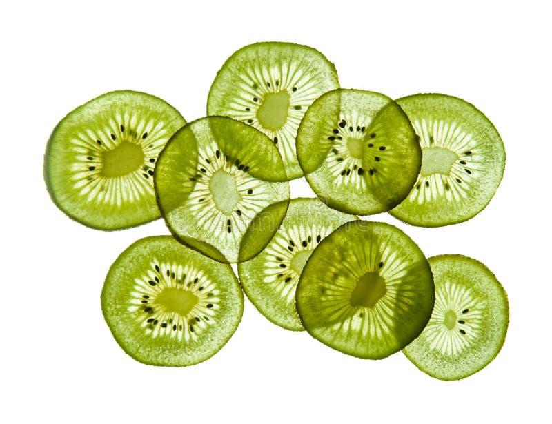 Slices of kiwi. Transparent fresh slices of kiwi isolated on white background royalty free stock image