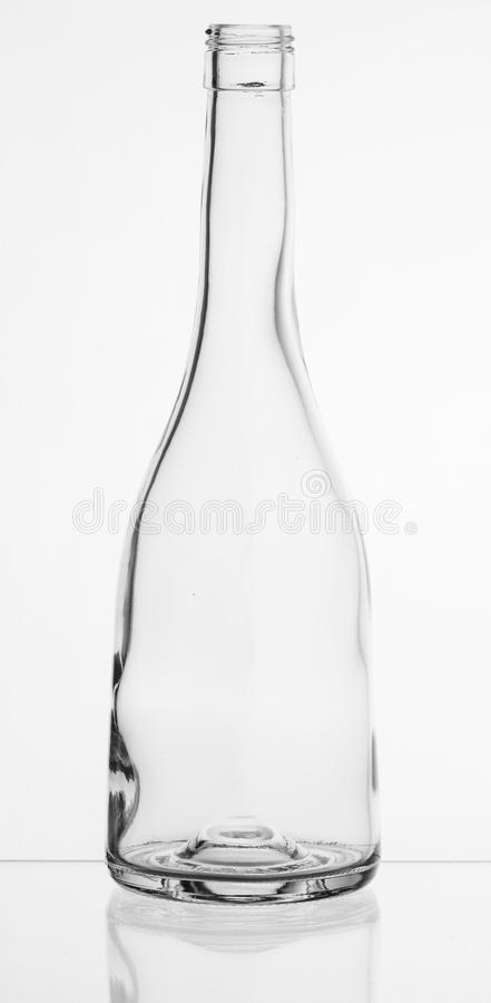 Transparent glass bottle. With reflection stock images
