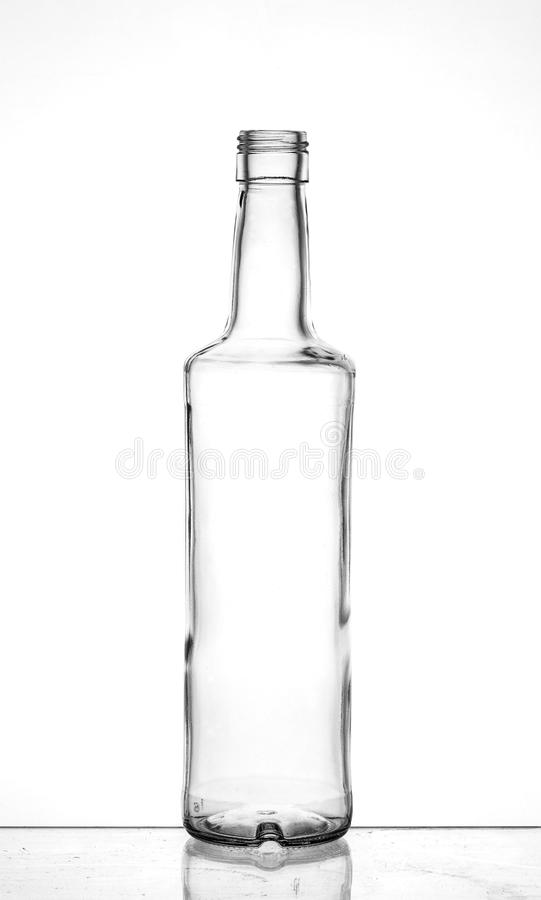 Transparent glass bottle. With reflection royalty free stock photos
