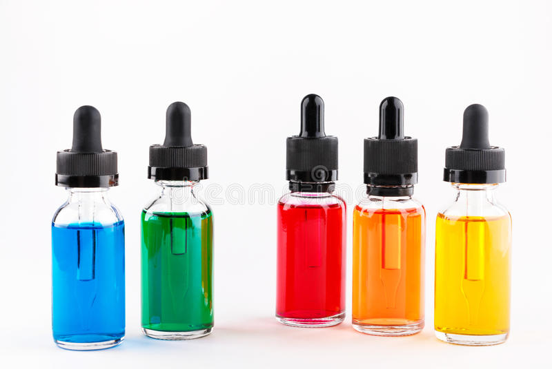 Transparent glass bottles filled colored liquid with dropper stock image