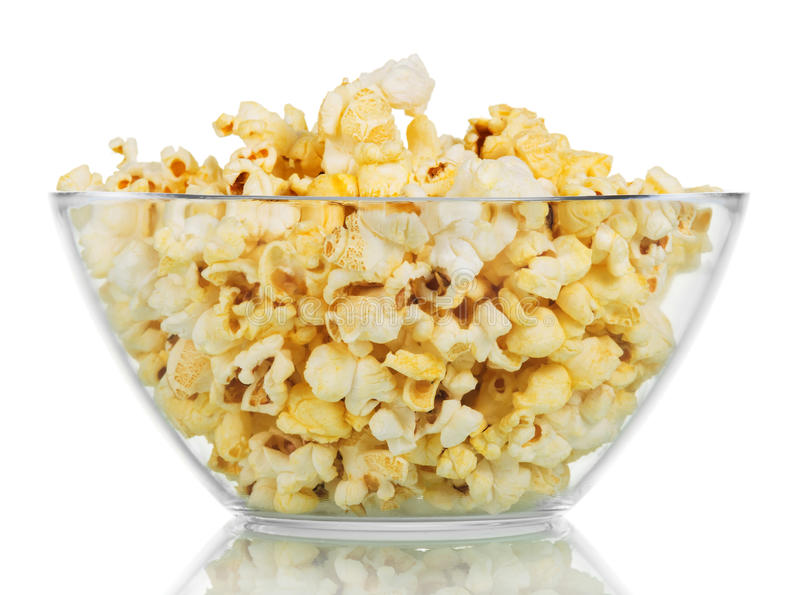 Transparent glass bowl with popcorn isolated on a white. Background stock photography