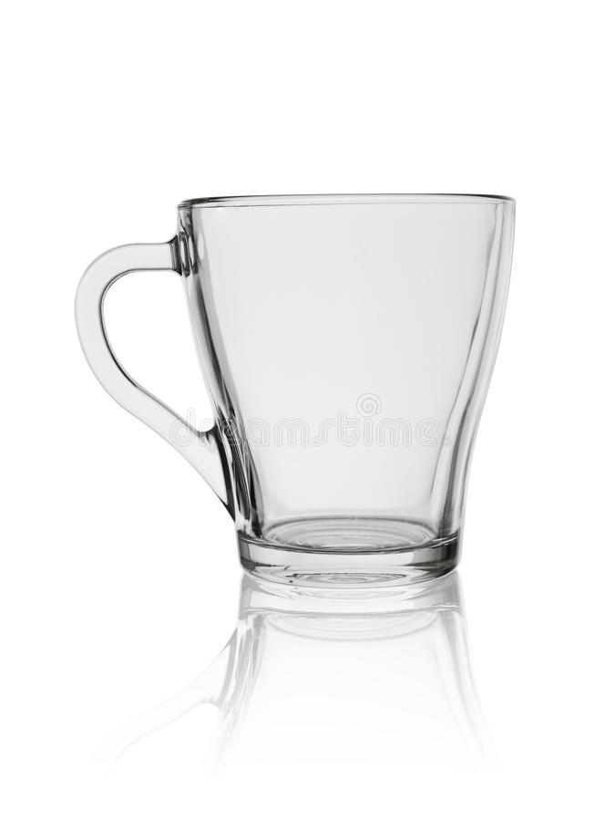 Transparent glass cup with the handle for tea or coffee isolated on a white background.  stock photo