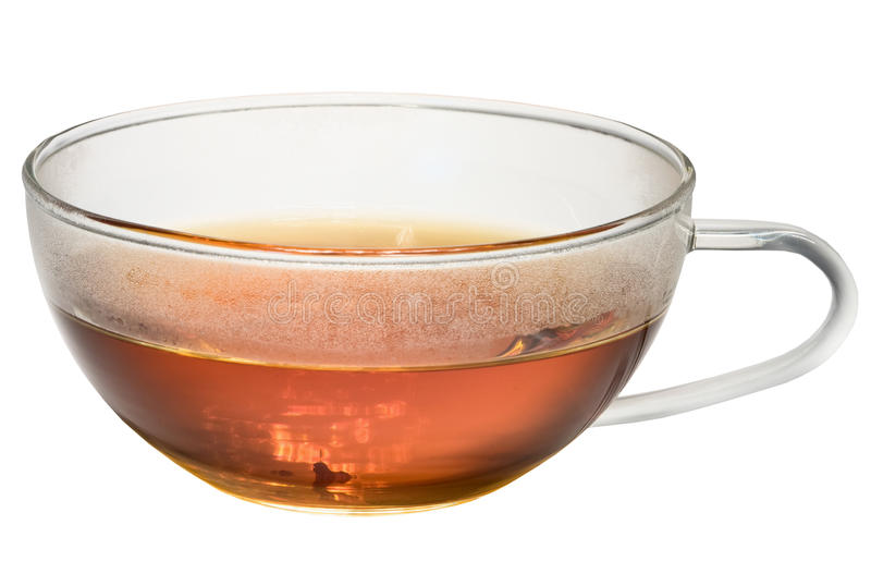 Transparent glass cup with tea on white background. Transparent glass cup with tea inside on a white background royalty free stock photos