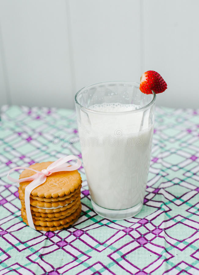 Transparent glass with milk and cookies. stock photo