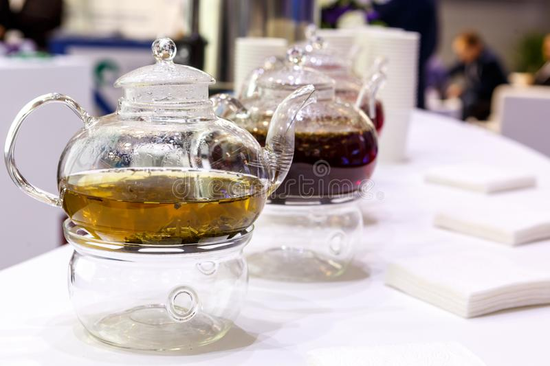 Transparent glass teapot with tea leaves royalty free stock photos