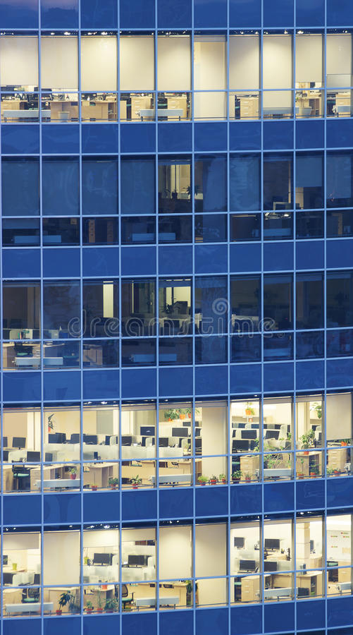 Transparent glass wall of business center with offices. Transparent glass wall of business center with many offices royalty free stock images