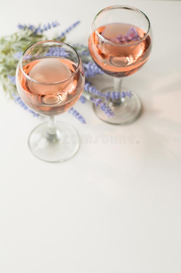 Transparent glass of wine. Pink wine. Festive mood. Alcohol for a group of friends. Delicious drink. Light background. Noble drink royalty free stock photo