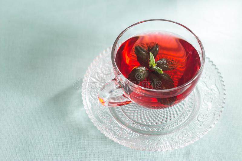 A mug of tea with mint stock images