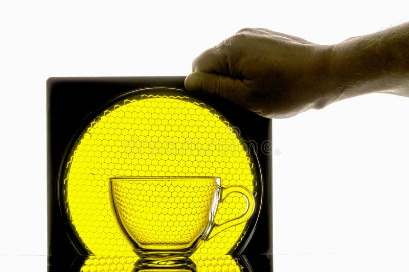 transparent mugholds hand on a background of yellow honeycomb royalty free stock images