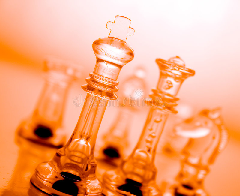 Transparent orange chess. Transparent chess on a orange background royalty free stock images