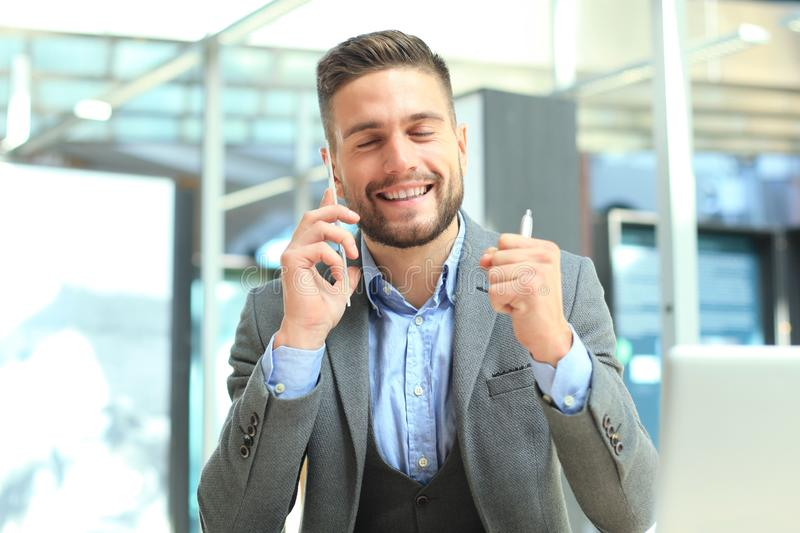 Transparent phones of the future concept, a Caucasian businessman having call with his friend.  royalty free stock images
